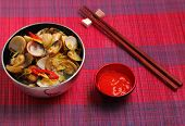 pic of clam  - herbal clam soup Vietnam style served on a place mat