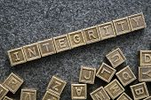 picture of integrity  - integrity word made from metallic blocks on blackboard surface - JPG