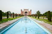 stock photo of india gate  - Front Gate Of The Taj Mahal and the pond - JPG