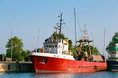 picture of outboard  - Image of a Commercial fishing boat in a harbor - JPG