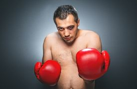 image of bruises  - Exhausted boxer over dark gray background - JPG