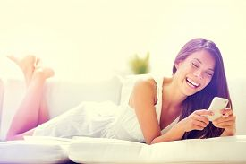 picture of cell  - Smartphone woman using app on mobile cell phone smiling happy - JPG