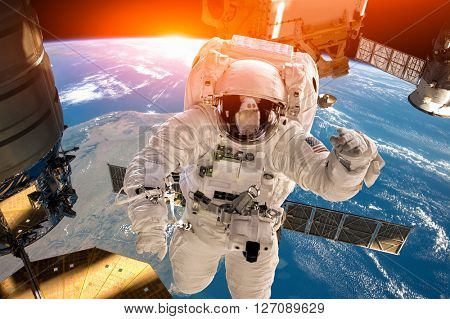 International Space Station and astronaut in outer space over the planet Earth. Elements of this ima