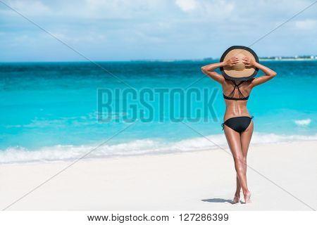 Summer vacation happiness carefree joyful woman standing on white sand enjoying tropical beach desti