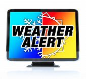foto of high-def  - A HDTV television with the words Weather Alert and a snowflake and sun on the screen - JPG