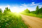 pic of dirt road  - road from sand and perfect summer day - JPG