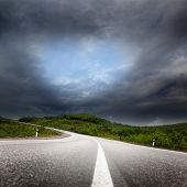 road and black clouds