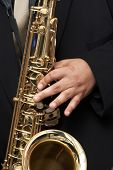 stock photo of musical instruments  - playing a brass horn  - JPG