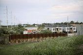 stock photo of katrina  - Level of the water on the rusty steel after Hurricane Katrina - JPG