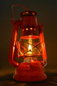 stock photo of kerosene lamp  - this is a lit old kerosene lantern - JPG
