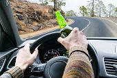 Drunk Young Man Driving A Car On The Road With A Bottle Of Beer. Dont Drink And Drive. Drunk Drivin poster