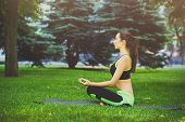 Young Woman Outdoors, Meditation Exercises. Girl Doing Lotus Pose For Relaxation. Wellness, Calmness poster