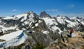 A Woman Hiker Views Thorton Peak And Mt Fury From The Summit Of Trappers Peak. North Cascades Nation poster