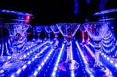 Empty Glasses Of Alcoholic Cocktails On The Colorful Bartender Show In The Restaurant With Lighting poster