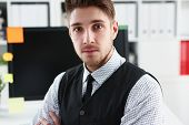 Handsome Man In Suit And Tie Stand In Office Looking In Camera Hands Crossed On Chest. White Collar  poster