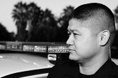foto of lightbar  - an Asian police officer staring off into the distance - JPG