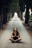 Carefree Woman Meditating In Nature.finding Inner Peace.yoga Practice.spiritual Healing Lifestyle.en poster