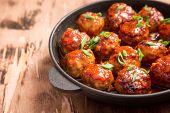 Meatballs In Sweet And Sour Tomato Sauce. Homemade Roasted Beef Meatballs In Cast-iron Skillet poster