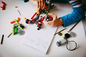 Little Boy Building Robot At Robotic Technology School Lesson, Stem Education poster
