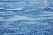 Water Surface With Ripples And Sunrays Reflections poster