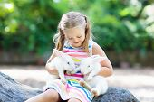 Child With Rabbit. Easter Bunny. Kids And Pets. poster