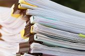 Stack Of Papers Documents In Archives Files With Clip Papers On Table At Offices,  Busy Offices And  poster