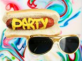Hot Dog in bun with the word PARTY in yellow mustard and Sunglasses on a Psychedelic Pattern Backgro poster