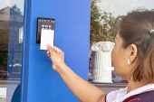 Door Access Control - Young Woman Holding A Key Card To Lock And Unlock Door., Keycard Touch The Sec poster