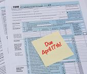 Irs 1040 Tax Form With Reminder For Taxes Due On April 17th poster