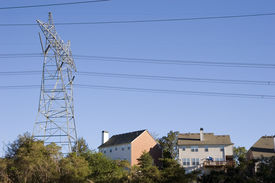 image of power lines  - High power electrical tower and lines over expensive houses - JPG