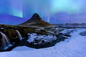 Mountain Kirkjufell And Aurora On The Sky In Iceland. poster