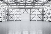 Empty Spacious Warehouse Interior With Closed Door poster