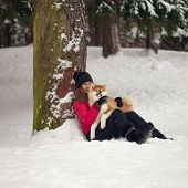 Portrait With A Cute Fluffy Puppy. Winter Walk With A Dog. Young Woman Walks With The Puppy, Snowy W poster