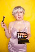 Happy Plus Size Woman Having Fun With Make-up Palette Set And Brush. Professional Multicolor Eyeshad poster