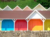 image of beach-house  - Exteriors of beautiful bright seaside beach chalets Scarborough England - JPG