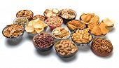 Pretzels, potato chips, crackers and other salty snacks isolated on white background poster