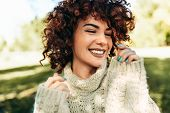 Close-up Portrait Of Beautiful Young Woman Smiling Broadly With Toothy Smile, Posing Against Nature  poster