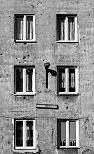 Monochrome Image Of Old Tenement In Capital Of Poland Warsaw In Praga District With Second World War poster