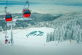 Admirable Snow Covered Trees And Winter Ski Resort With Colorful Fast Cable Cars. Ski Slope And Froz poster