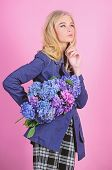 Must Have Concept. Clothes And Accessory. Woman Blonde Hair Posing Coat With Flowers Bouquet. Fashio poster