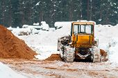 Yellow Caterpillar Tractor. Heavy Tractor, Construction Machinery, Industrial Vehicle. Winter Time poster