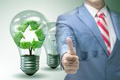Green energy anc ecology concept with businessman poster