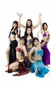Asian Belly dance troupe posing on white background