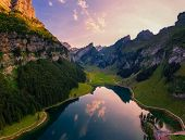 Aerial View Of The Seealpsee Lake And The Grenzchopf Mountain In The Appenzell Region Of Swiss Alps  poster