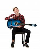Full Length Portrait Of Talented Boy Teenager With His Trendy Acoustic Guitar Seated On Chair Thinki poster