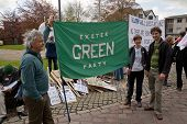 Members Of Exeter's Green Party Gather At Exeter Cathedral Yard As Part Of The May Day Rally Against