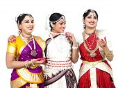 picture of bharatanatyam  - three pretty female dancers   of indian origin having a discussion - JPG
