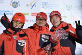 BUKOVEL, UKRAINE - FEBRUARY 23: Sicun Xu (left), Chao Wu (center) and undefined member of Chinese te