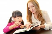 stock photo of japan girl  - Little girl studying in English with teacher