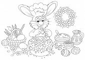 image of cony  - Rabbit decorating an Easter cake to the upcoming holiday - JPG